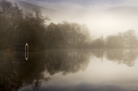 Loch Ard misty boathouse
